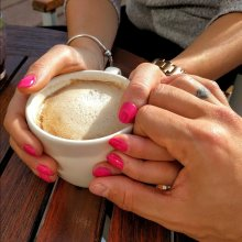 Couple Holding Hands Over Coffee - Key to Healthy Relationships