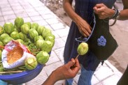 buying 'amra' from street vendor