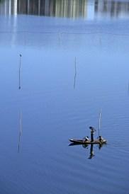 Taxi boat crossing lake