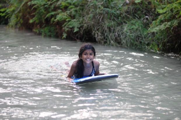 cruising down eli creek on boogie board