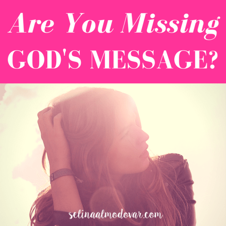 "girl looking to the side with her hand combing through her hair with pink overlay and white text that reads, ""Are You Missing God's Message?"""