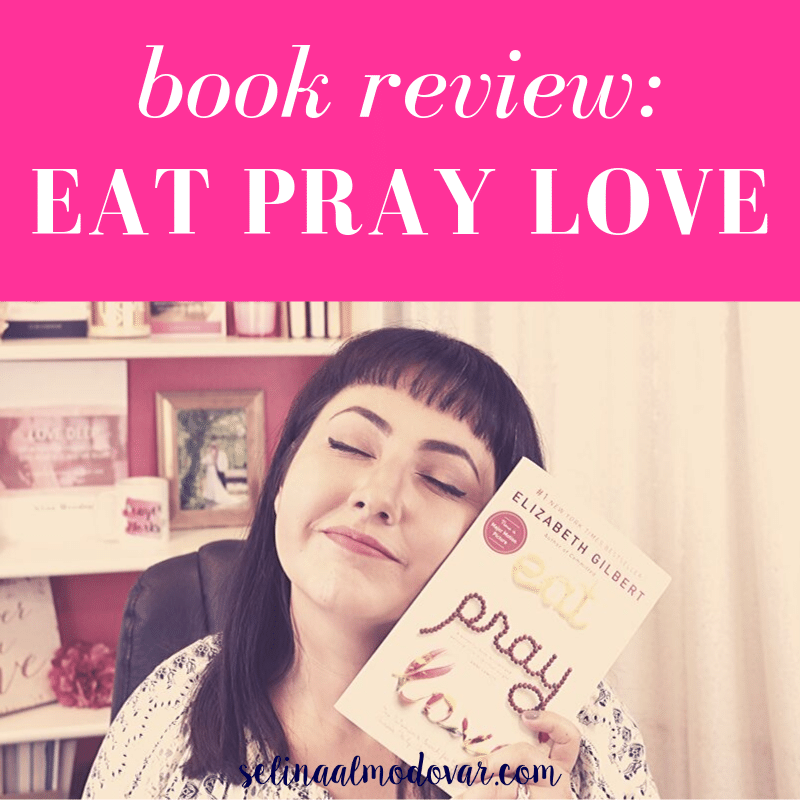 "Selina Almodovar smiling with her eyes closed while holding up the book, ""Eat Pray Love"" to the side of her face sitting in front of a bookshelf with pink overlay and white text that reads, ""Book Review: Eat Pray Love"""