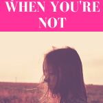 """girl staring down at a field with blank stare while hair blows around her from the wind with pink overlay and white text that reads, """"Stop Pretending You're Over Him When You're Not"""""""
