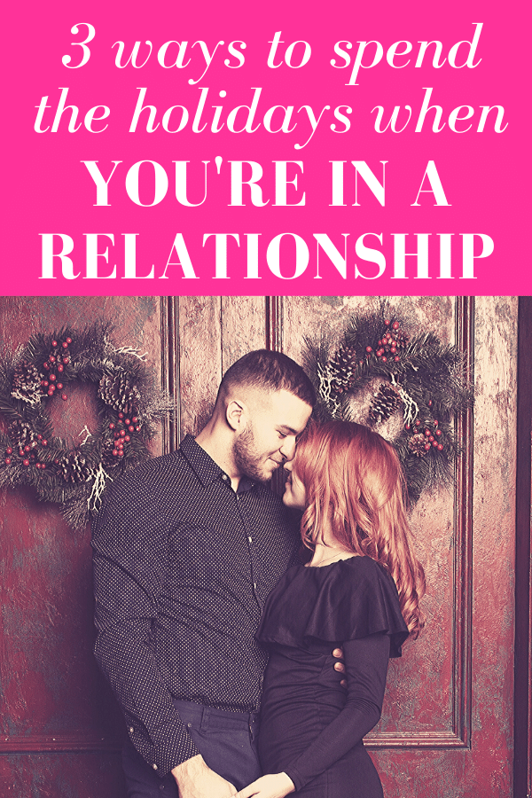 "guy facing girl as both smile while standing in front of wood door adorned with christmas wreaths with pink overlay and white text that reads, ""3 Ways to Spend The Holidays When You're In A Relationship"""