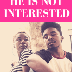 "guy looking off to the side with his elbows rested on his knees while a woman sits in the background and looks towards the guy with pink overlay and white text that reads, ""5 Reasons Why He Is Not Interested"""