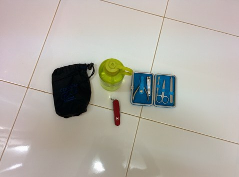 1 nail kit, 1 swiss army knife, 1 water bottle, 1 sleeping bag liner
