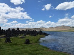 By the lake. The stacked rocks (ovoo) are a shamanist/buddhist tradition for worship of the sky/mountains.