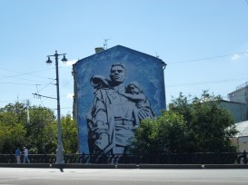A WWII mural on a building.