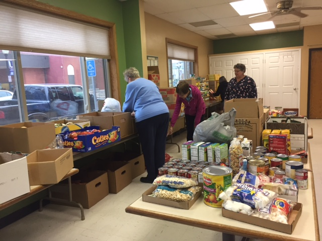 photo of Volunteers preparing for Thanksgiving food giveaway