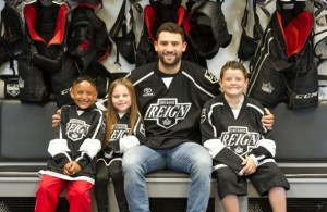 Ontario Reign forward Paul Bissonnette with Jr. Reign players