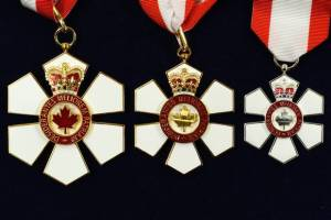 The three insignia of the Order of Canada, Dr. Tator's proudest honor