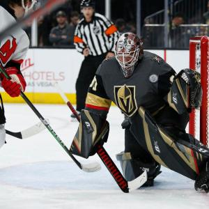 Lehner making a save in a game against the New Jersey Devils
