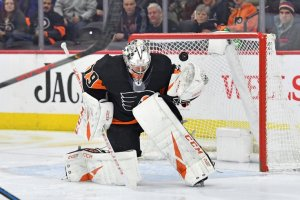 Carter Hart makes a hybrid save in a game against the New York Rangers