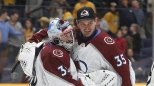 Hutchinson (right) embracing Pavel Francouz after an Avalanche win