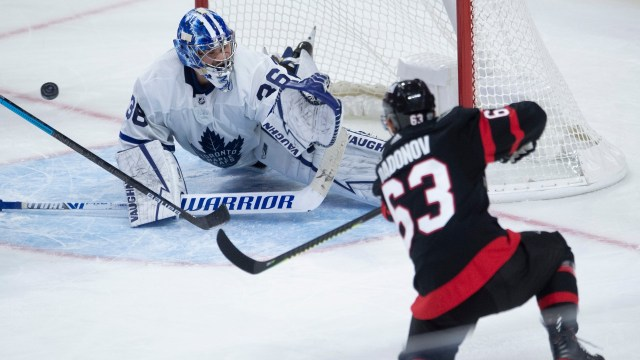 Jack Campbell makes a save on Ottawa Senators forward Evgenii Dadonov.