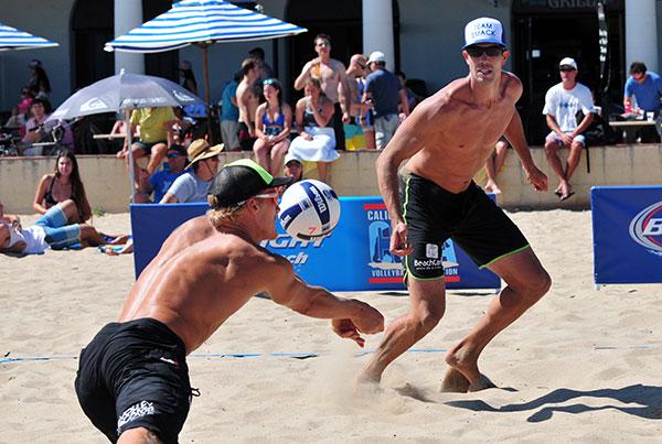 Mark Burik passes the ball as partner Curt Toppel at the CBVA Santa Barbara Open.