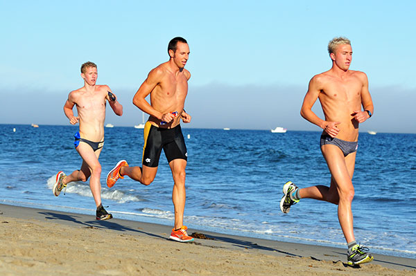The top three in the beach biathlon, led by winner Cuyler Gabriel, right.