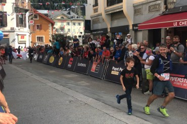 a runner and a child finish the 2018 UTMB ultramarathon