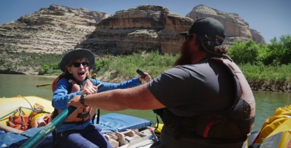 kathy leonard tries her hand at rowing a raft on the Green River, June 2018