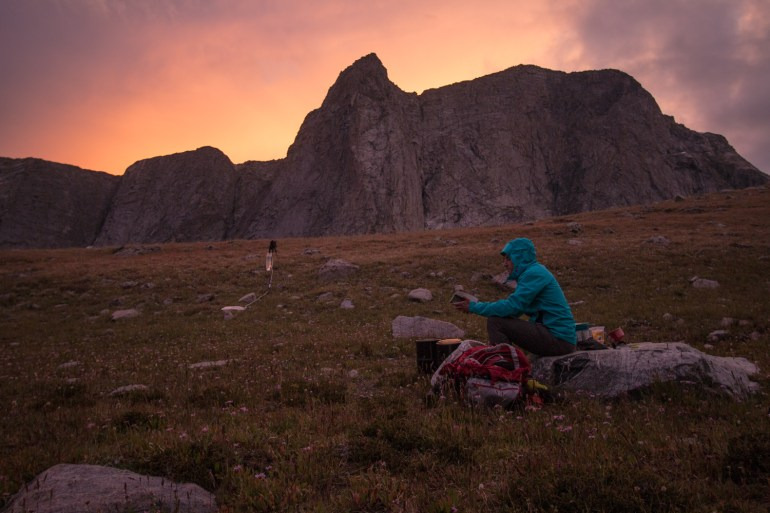 Brendan Leonard journals in front of Ambush Peak after a day of backpacking in the Wind River Range