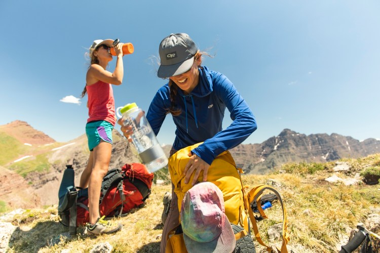 forest woodward photo of hiker packing backpack