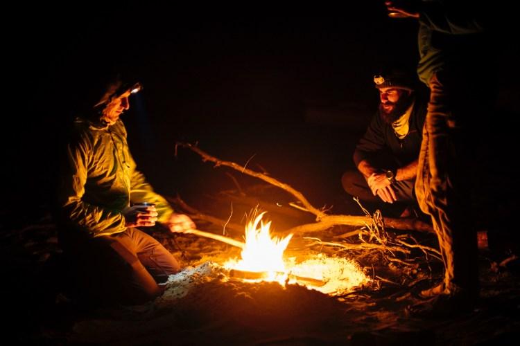 forest woodward photo of friends around campfire