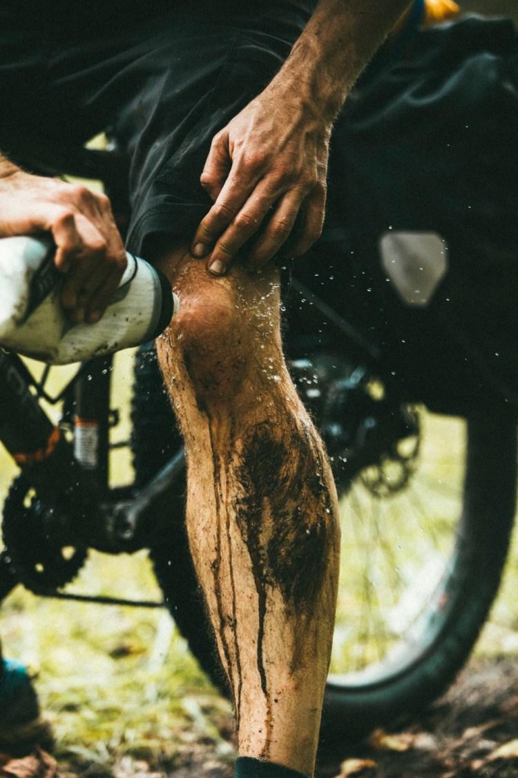 forest woodward photo of cyclist washing mud off leg