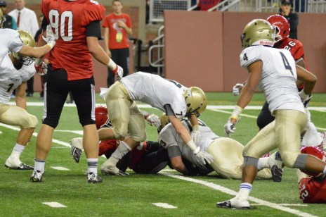 McTaggart pulls down the Eaglet running back in the state championship game at Ford Field