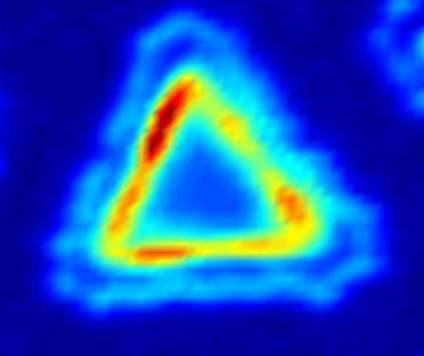 This photoluminescence intensity map shows a typical piece of the lateral heterostructures. The junction region produces an enhanced light emission, indicating its application potential in optoelectronics. (Source: University of Washington)