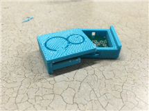 The 8-Count chip and casing. Current versions are small enough to fit into a mouthguard. (Source: ECE Illinois)