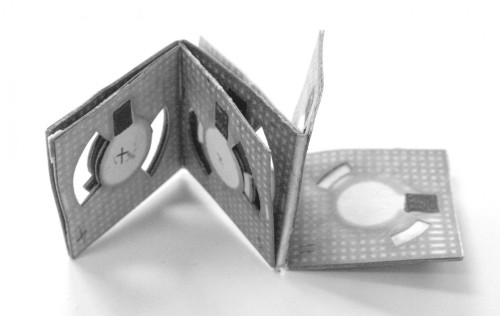Origami batteries like this one, developed by Binghamton University researcher Seokheun Choi, could one day power biosensors for use in remote locations. (Source: Jonathan Cohen/Binghamton University)