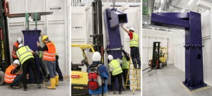 FXE group members install the robot tower. Source: European XFEL)