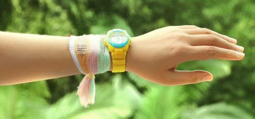 A bracelet made from fabric woven with special energy-harvesting strands that collect electricity from the sun and motion. (Source: Georgia Tech)
