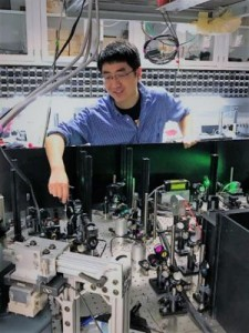 Brian Zhou, postdoctoral scholar at the Institute for Molecular Engineering at the University of Chicago, aligns the lasers onto the diamond chips used in the experiments. (Source: University of Chicago)