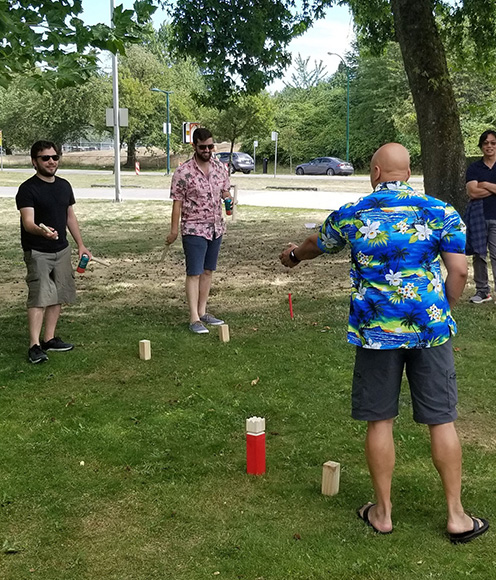 a group of people playing a game outdoors