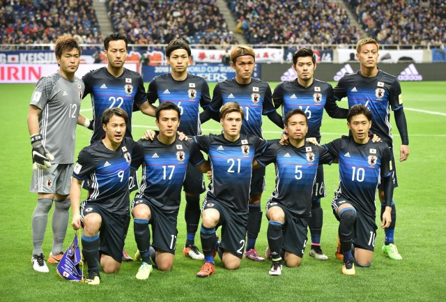 Starting players of Japan pose during a photo session prior to their 2018 World Cup qualifier Asian second-round Group E football match between Japan and Syria in Saitama. (JIJI PRESS/AFP/Getty Images)