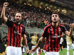 AC Milan's Argentine forward Gonzalo Higuain (L) and AC Milan's Italian forward Patrick Cutrone celebrate after Higuain scored during the Europa League Group F football match between AC Milan and Olympiakos at the San Siro stadium on October 4, 2018 in Milan. (Photo by Miguel MEDINA / AFP) (Photo credit should read MIGUEL MEDINA/AFP/Getty Images)