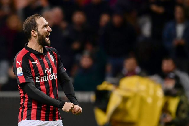 AC Milan's Argentinian forward Gonzalo Higuain celebrates after scoring during the Italian Serie A football match AC Milan vs Sampdoria at the 'Giuseppe Meazza Stadium' in Milan, on October 28, 2018. (Photo by MARCO BERTORELLO / AFP) (Photo credit should read MARCO BERTORELLO/AFP/Getty Images)