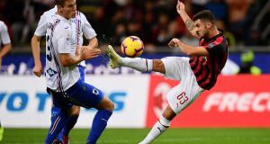 AC Milan's forward Patrick Cutrone from Italy (R) fights for the ball with Sampdoria's defender Joachim Andersen from Denmark during the Italian Serie A football match AC Milan vs Sampdoria on October 28, 2018 at the 'Giuseppe Meazza Stadium' in Milan. (Photo by MARCO BERTORELLO / AFP) (Photo credit should read MARCO BERTORELLO/AFP/Getty Images)