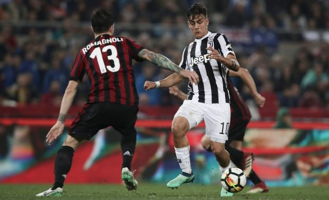 Juventus' forward from Argentina Paulo Dybala (R) vies with AC Milan's defender from Italy Alessio Romagnoli during the Italian Tim Cup (Coppa Italia) final Juventus vs AC Milan at the Olympic stadium on May 9, 2018 in Rome. (Photo by Isabella BONOTTO / AFP) (Photo credit should read ISABELLA BONOTTO/AFP/Getty Images)
