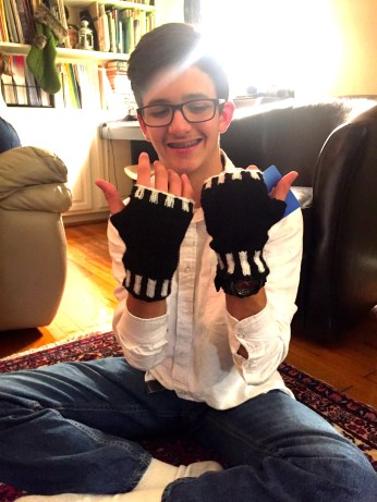 Hand-knitted fingerless gloves made by a student.