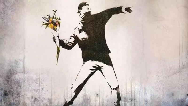 Ragazzo che lancia fiori Bansky