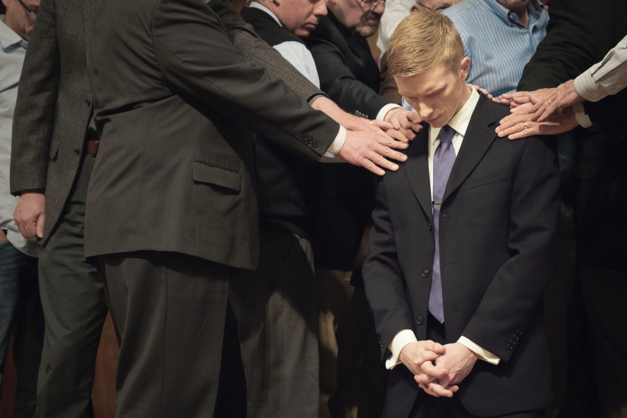 young pastor being ordained