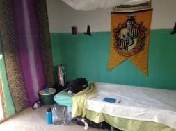 My cot and water corner, along with some Hufflepuff pride!