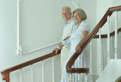 Older couple walking down stairs
