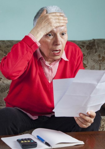 Senior,Old,Woman,Shocked,With,The,Bills,She,Receives,,Appalled