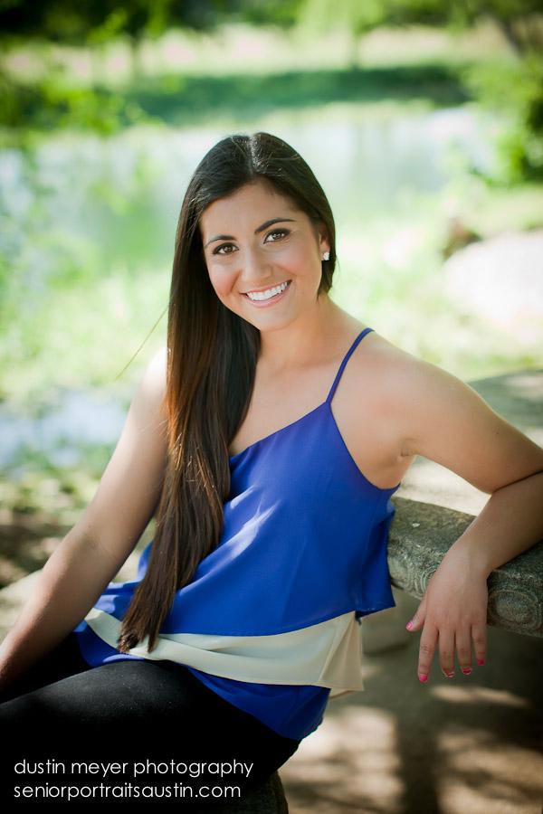 A brunette teen female senior portrait model poses at Dustin Meyer Photography in Austin, TX.