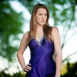 Brunette teen female model purple prom gown senior portraits fashion