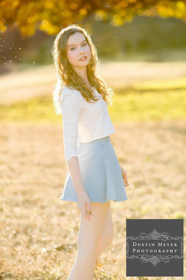 gorgeous female senior portraits blue skirt white button long sleeve shirt blonde curly hair blue eyes senior portraits ideas