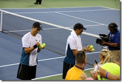 Bryans signed dozens of balls and hit them into the stands,  then dozens of autographs for fans.